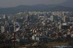 Urban sprawl around Hwaseong fortress in Suwon, outside of Seoul, Korea.